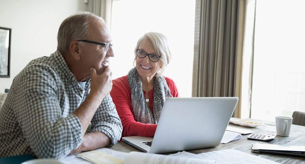 A retiring couple researching and getting answers to what is Medicare